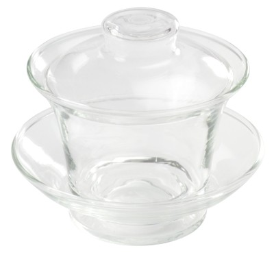 glass cup with lid and saucer
